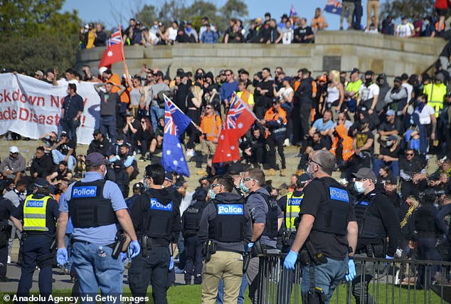 Health Minister Martin Foley commented the Covid positive protestor was so unwell they had to be hospitalised (pictured police officers attend protests in Melbourne on September 22)
