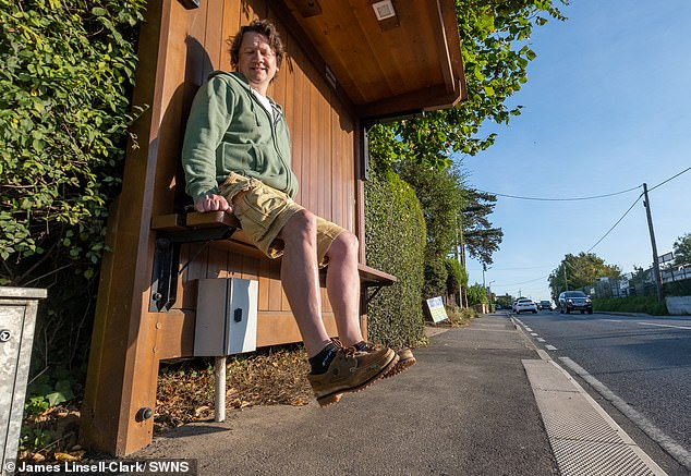 Councillor Paul Thorogoode at the bus stop in Fleering, Essex, with the high seat