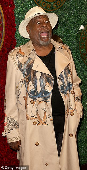 Excited: George Clinton put on a lively display while cutting a very fashionable stone trench coat with nautical prints