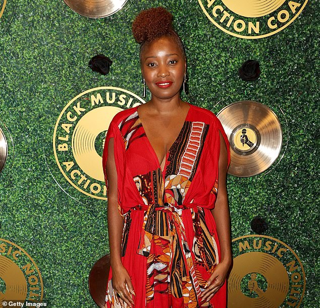 Dazzling: Isley Nicole Melton stunned in a red jumpsuit with orange, black and white prints