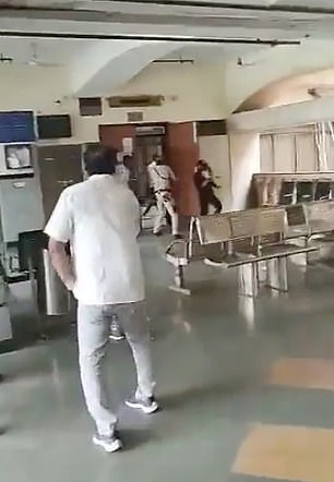A notorious Indian gangster has been gunned down in a courtroom by two hitmen disguised as lawyers before they were shot dead by police