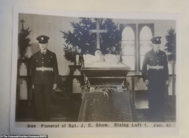 The collection of over 40 photos, also featuring poignant images of a funeral at Stalag Luft I, were found in boxes in a Gloucestershire barn. Above: British troops pose next to the body of a soldier named as Sergeant J. C. Shaw