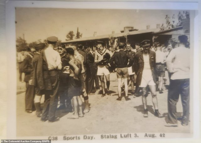 Inmates mill around during the camp's sports day in August 1942. Many of the men are seen wearing their RAF uniforms