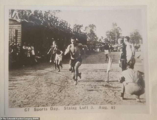 The vendor, who had no idea the photos existed, is selling them with the Cotswolds Auction Company. Above: An athletic inmate taking part in a sprint race during the camp's sports day