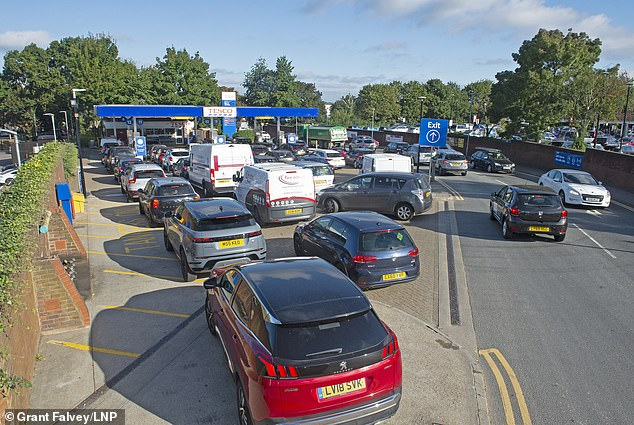 SIDCUP, KENT: Queues of cars spill out on the road from a Kent forecourt today after fuel bosses warned of rationing and petrol station closures