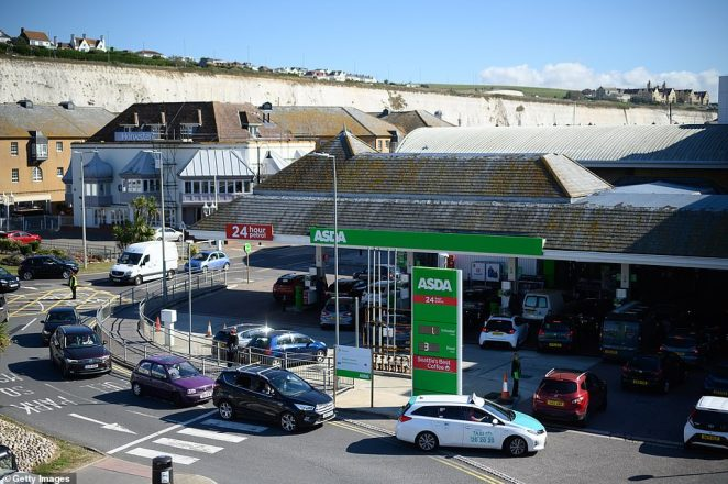 A stacked up Asda garage in Brighton as the panic buying of fuel continued to escalate today
