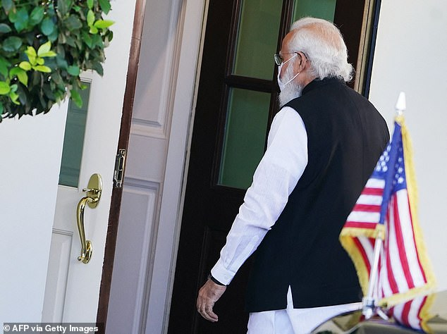 India's Prime Minister Narendra Modi walks into the West Wing on Friday for his morning meeting with President Joe Biden. It marks the first time the two leaders meet face-to-face