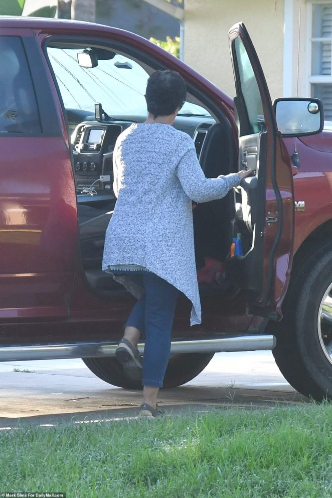 Roberta Laundrie gets into the passenger seat as she leaves the house Thursday morning