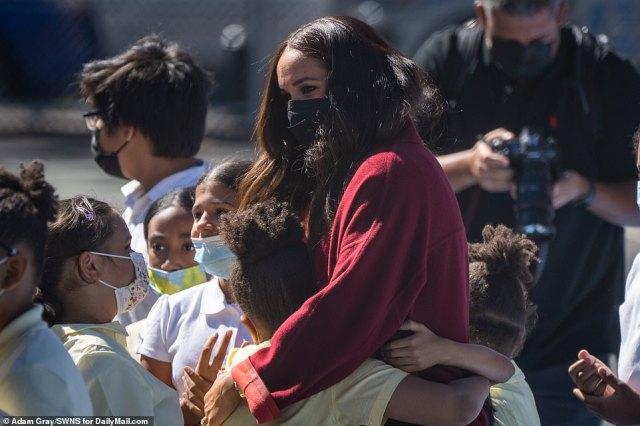 Meghan hugs students at PS 123 Mahalia Jackson school in Harlem, New York City, during the visit Friday morning