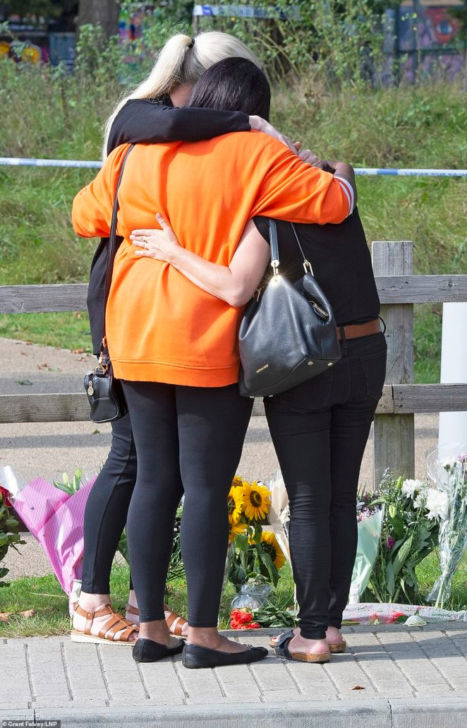 Sabina's friends embrace as they pay their respects at the entrance to Cator Park, south east London on Tuesday