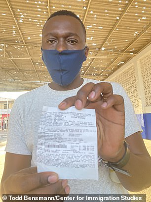 A Haitian migrant showed DailyMail.com his ticket at the bus station is Ciudad Acuna, Mexico