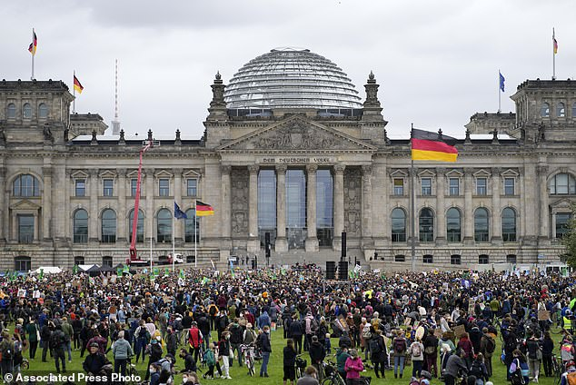Activist gather for a Fridays for Future global climate strike in front of the Reichstag parliament building in Berlin, Germany