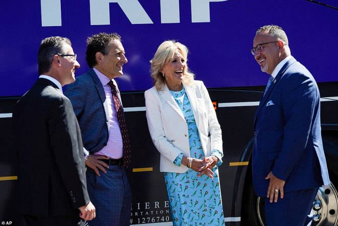 The first lady speaks with, from left, Chancellor Peter M. Provenzano, Jr., Levin, D-Mich., and Education Secretary Miguel Cardonas
