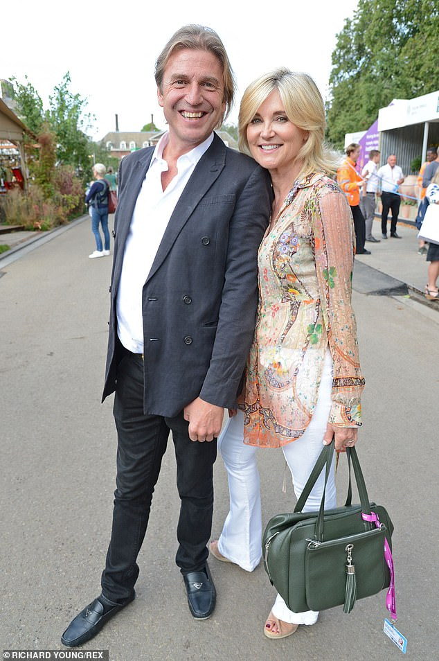 Anthea Turner, 60,never lived down posing for a cheesy picture for a magazine while biting into a Cadbury's Snowflake bar at her wedding to businessman Grant Bovey so is fleeing overseas for her forthcoming wedding to socialite Mark Armstrong (pictured together)