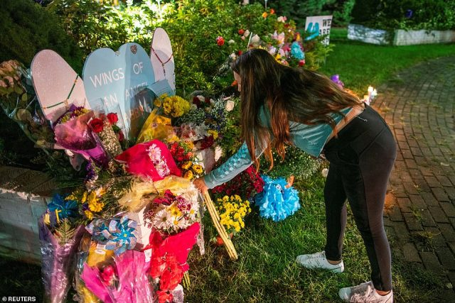 Other residents set put up flowers to display at one of the sites besides a display that read 'Wings of An Angel Gabby'