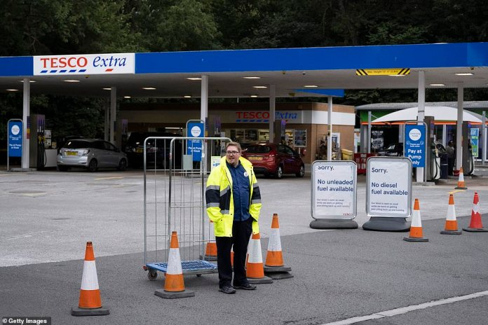 The news led to a race to the petrol pumps (pictured in Cardiff, Wales) with the result that hundreds ran out of some fuel types and dozens closed altogether