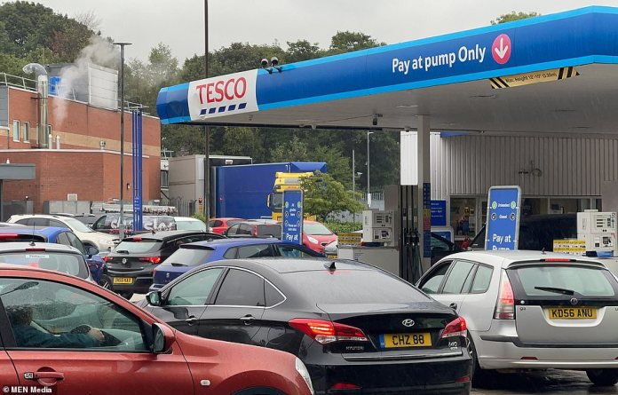 Driver shortages are hitting every part of the economy, creating gaps on supermarket shelves, leaving pubs and restaurants short of key produce and jeopardising the supply of key chemicals to water firms (pictured, people queueing for fuel in Rochdale)