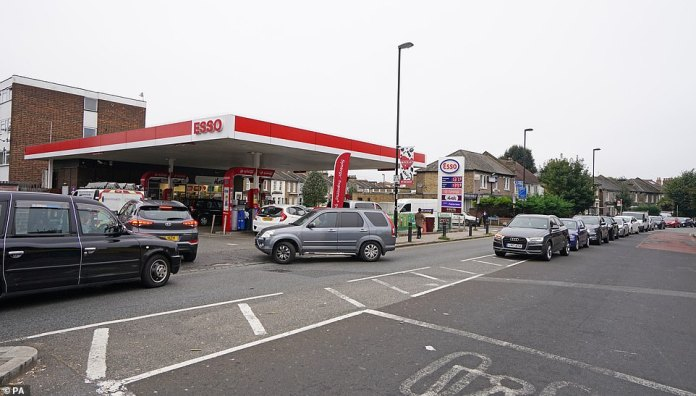 Motorists queue for petrol at an Esso petrol station in Brockley, South London, amid a shortage of drivers to bring the fuel to stations this weekend