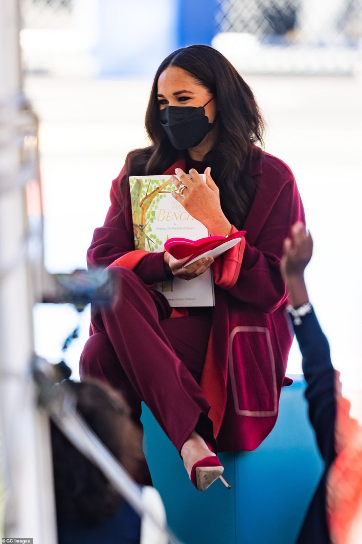 Meghan reads her book The Bench to children at a Harlem school Friday.Meghan and Harry are set to appear at Global Citizen Live in New York City's Central Park Saturday