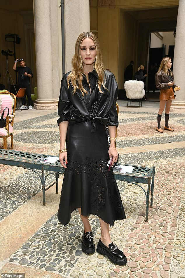 Looking good:Olivia Palermo oozed confidence in a black leather knot-front shirt as she made a stylish arrival at the Ermanno Scervino show during Milan Fashion Week on Saturday