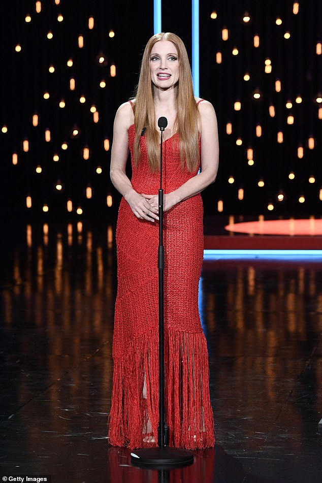 Lady in Red: Jessica Chastain, 44, looked glamorous in red as she received the Silver Shell Award for Best Lead Actor at the San Sebastian Film Festival in Spain on Saturday.