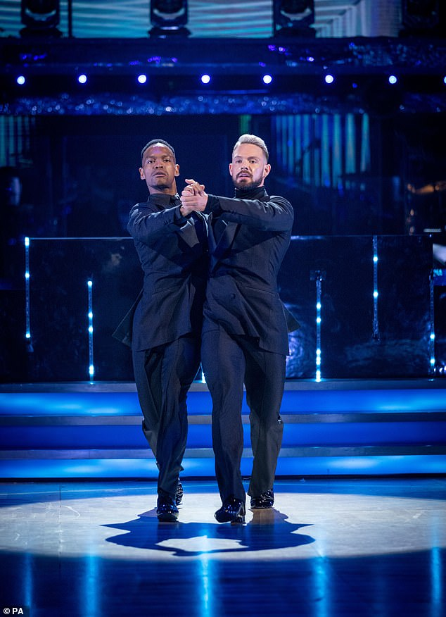 Fleeting: In the series' first live show on Saturday, 32-year-old Jon White and 34-year-old Johannes Radebe dance as the BBC competition's first all-male pair