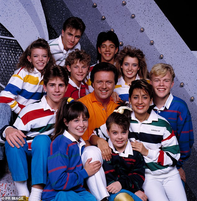 Memories: The singers took turns speaking fondly of Young Talent Time and its creator Johnny Young, 74, with Arena saying she felt 'lucky' to have been 'protected' from unsafe situations while on-set. Pictured: Young posing with the cast of Young Talent Time