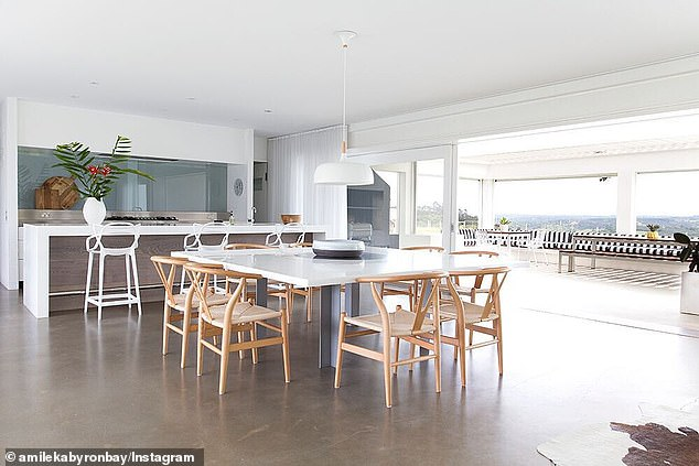 Spacious: the modern kitchen has large folding doors, which open onto an outdoor terrace and dining area