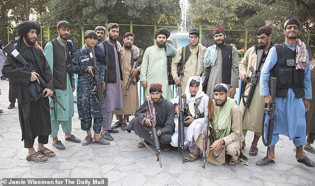 Relaxing Taliban fighters, still carrying their weapons, join families and children at Kabul Zoo to see some of the star attractions: a White lion, an Afghan leopard, wolves, ducks, pelicans and the ever popular bunny rabbit
