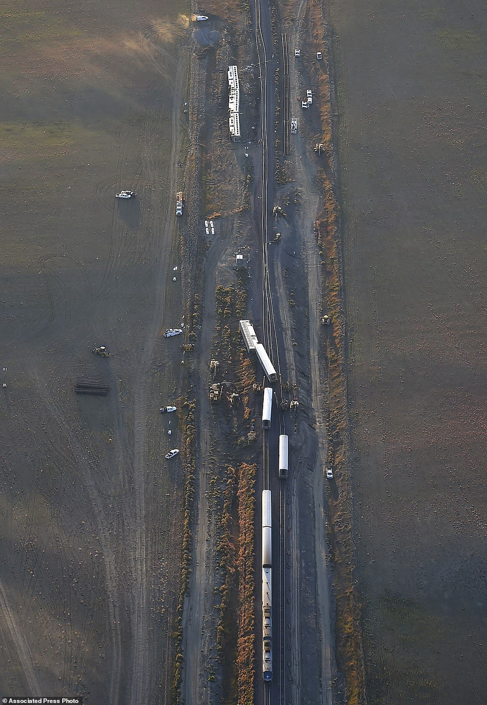 This aerial view taken Sunday, Sept. 26, 2021, shows an Amtrak train that derailed in north-central Montana Saturday that killed multiple people and left others hospitalized, officials said. The westbound Empire Builder was en route to Seattle from Chicago, with two locomotives and 10 cars, when it left the tracks about 4 p.m. Saturday. (Larry Mayer/The Billings Gazette via AP)
