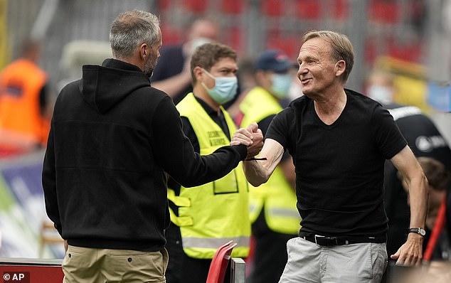 Dortmund CEO Hans-Joachim Watzke (right) said reports the club should sell are 'bull**t'
