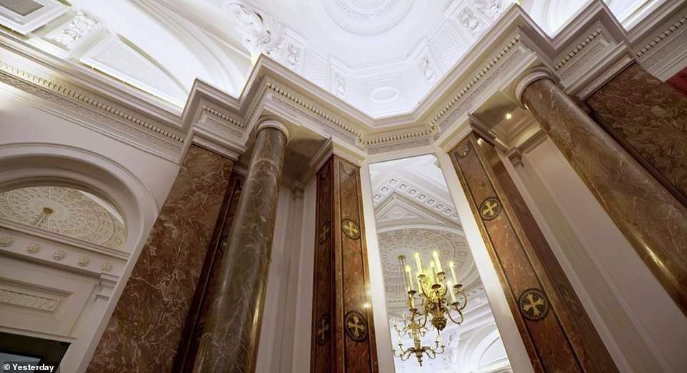 Above: The Tuscan-inspired marble pillars rise up to a bright white ceiling which is decorated with octagonal patterns