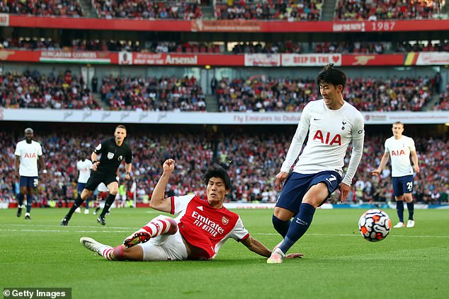 Takehiro Tomiyasu (left) also managed to keep the dangerous Son Heung-Min (right) quiet