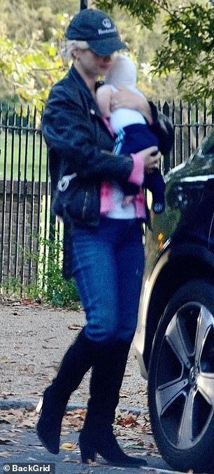 Out: Pixie Geldof ventured out with her baby daughter and husband George Barnett on Monday afternoon in an appearance in London - just weeks after giving birth