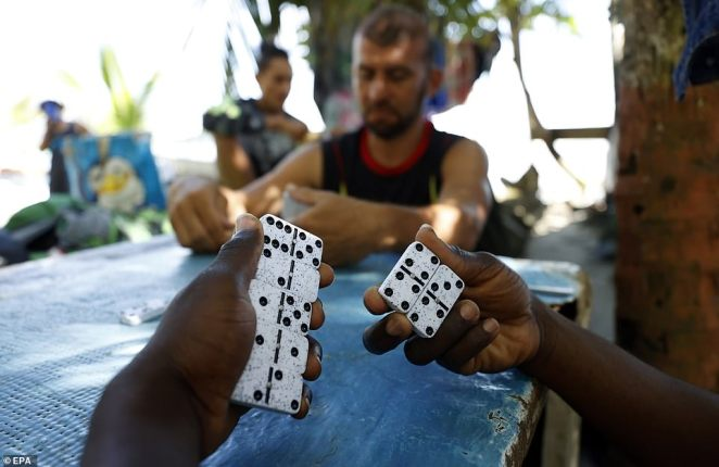 Some Haitians were seen playing games, including dominoes, with fellow Venezuelan travelers who are also hoping to seek asylum in the U.S.