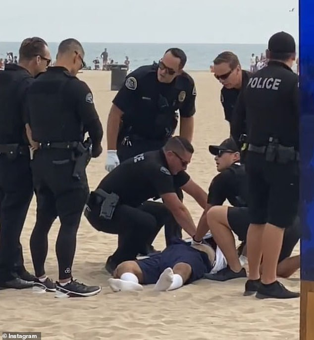 Witnesses said two cops opened fire at Garcia at close range at the crowded California beach