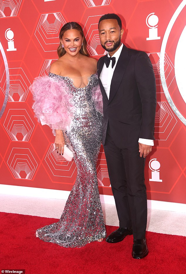 She shines: Chrissy gave her all on Sunday as she wore a plunging silver sequin dress with pink sleeves that made the most of her looks for the Tony Awards