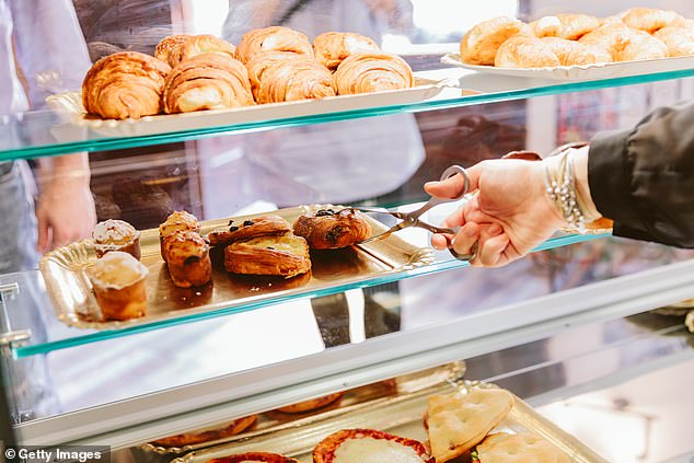 Marcelle, 62, selected a cinnamon swirl from the shelves displaying the retailer¿s ¿Made Without¿ range of products; made without major food allergens such as nuts, dairy, egg and wheat [File photo]