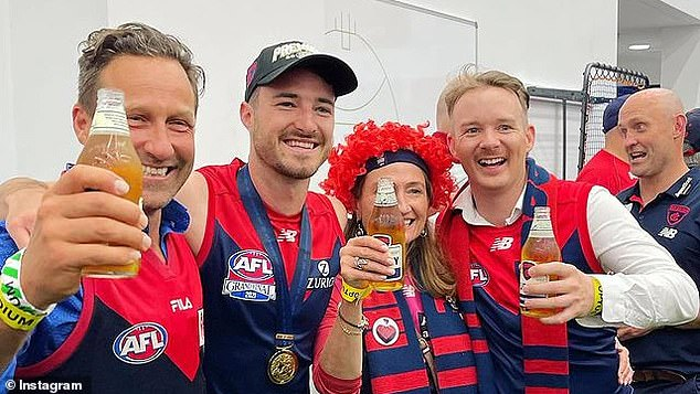 Burbank (left) was photographed celebrating the win was by an AFL photographer and uploaded on their official Instagram page