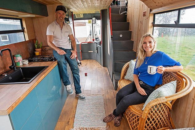 All aboard: Lamorna and Gareth converted double decker bus £5,000 .  bought for