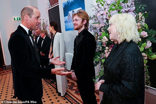 Chit chat: The Eilish siblings also traded words with Prince William, the Duke of Cambridge, ahead of the James Bond movie premiere. 'I'm sort of weirdly present when I'm meeting people like the royal family at the Bond thing,' Finneas said.