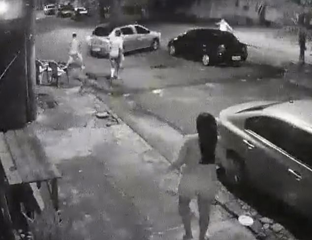 A driver speeds away after he was captured on camera plowing his vehicle into a man and his five-year-old son, who had been blocking the street while he rode his bicycle Sunday night in Pará, Brazil. The motorist has not been arrested