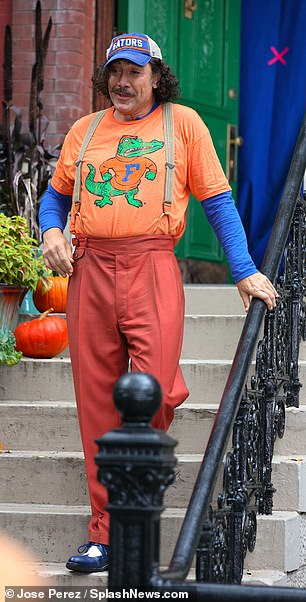 Unique: The 52-year-old thespian sported a fluorescent orange Florida Gators shirt with a blue long-sleeve for scenes filmed on a stoop in uptown Manhattan