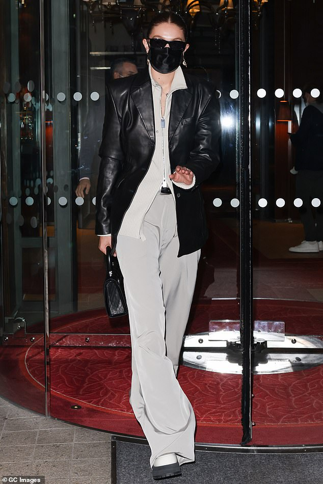 Off duty:Gigi Hadid looked every bit the off duty model on Tuesday night as she stepped out in Paris, France during PFW