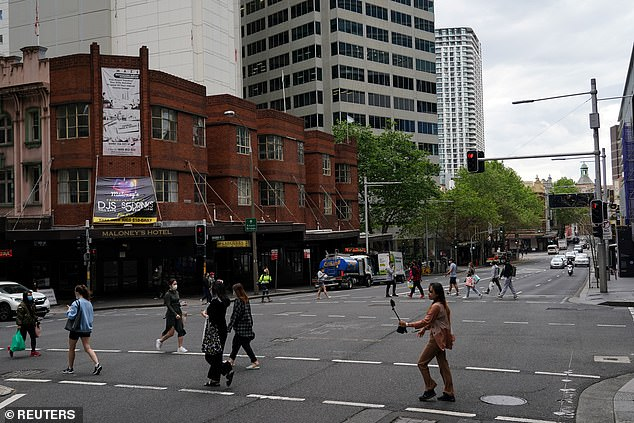 With Sydney (city centre pictured) and Melbourne in lockdown, Governor DeSantis has likened Australia to China