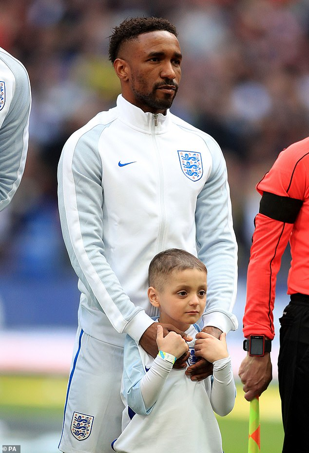 Jermain Defoe, then of Sunderland FC, and England mascot Bradley Lowery line up prior to the FIFA 2018 World Cup Qualifier between England and Lithuania