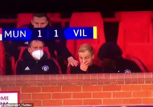 Van de Beek (centre) was furious in the Manchester United dugout after he was left to watch the action yet again against Villarreal last month