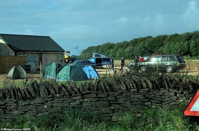 Actors posing as Environmentalists camped next to Diddly Squat farm with a banner saying'Soil has feeling, Clarkson doesn't'