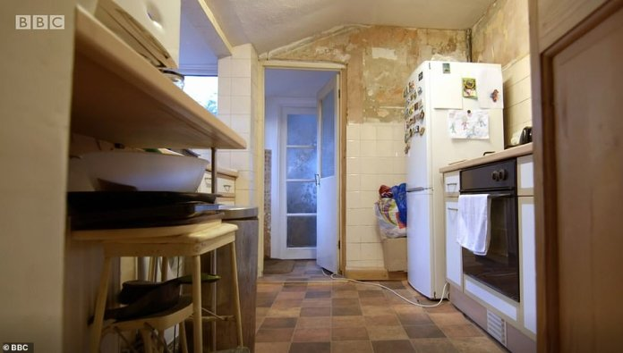Before the kitchen: The reception room had a cramped kitchen, which led to a bathroom at the back of the house.  It was 'standing room only' and Jacqueline struggled with lack of storage and cooking space