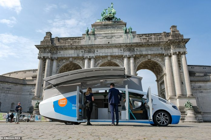 The Stella Vita is pictured in front of the Arcade du Cincenteniere in Brussels, Belgium, earlier this month.  Its European tour aims to 'show the rest of the world what is already possible for a sustainable future in terms of energy and mobility'